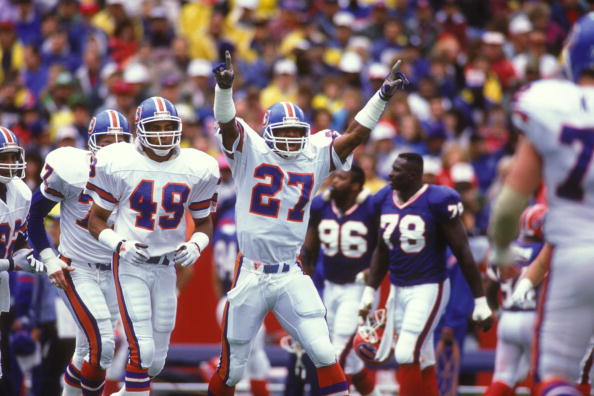 ORCHARD PARK, NY - SEPTMEBER 30: Steve Atwater #27 of the Denver Broncos celebrates a touchdown during a NFL football game against the Buffalo Bills on September 30, 1990 at Rich Stadium in Orchard park, New York. (Photo by Mitchell Layton/Getty Images)