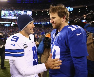 EAST RUTHERFORD, NJ - NOVEMBER 24: Tony Romo #9 of the Dallas Cowboys and Eli Manning #10 of the New York Giants meet after the 24-21 win by the Cowboys at MetLife Stadium on November 24, 2013 in East Rutherford, New Jersey. (Photo by Al Bello/Getty Images)