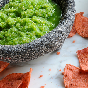 "This ""green salsa"" packs a fresh and spicy flavor. Ideal for chip dipping or for adding extra zest to many Mexican entrees."