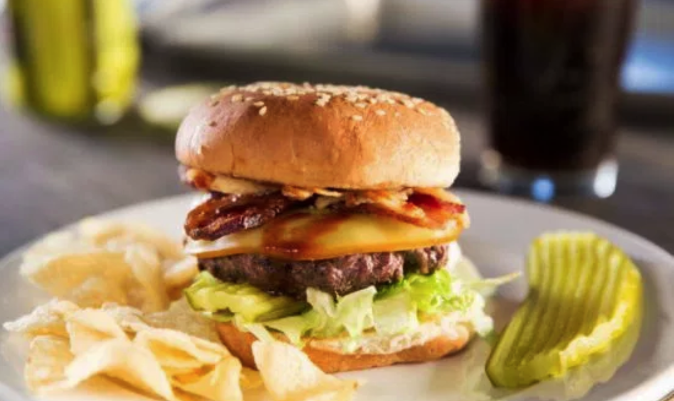 It might not be hamburger, but it still counts! Bacon, crispy onion straws, barbecue sauce and pickles add bold flavor to this bison burger recipe, but they're just as delicious topped with your own favorite condiments!