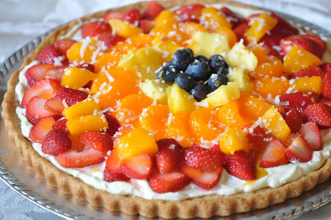 This refreshingly sweet Fresh Fruit Dessert Pizza with Coconut Cream has a sugar cookie base topped with alight and fluffy coconut cream cheese and delicious bites of fruit!