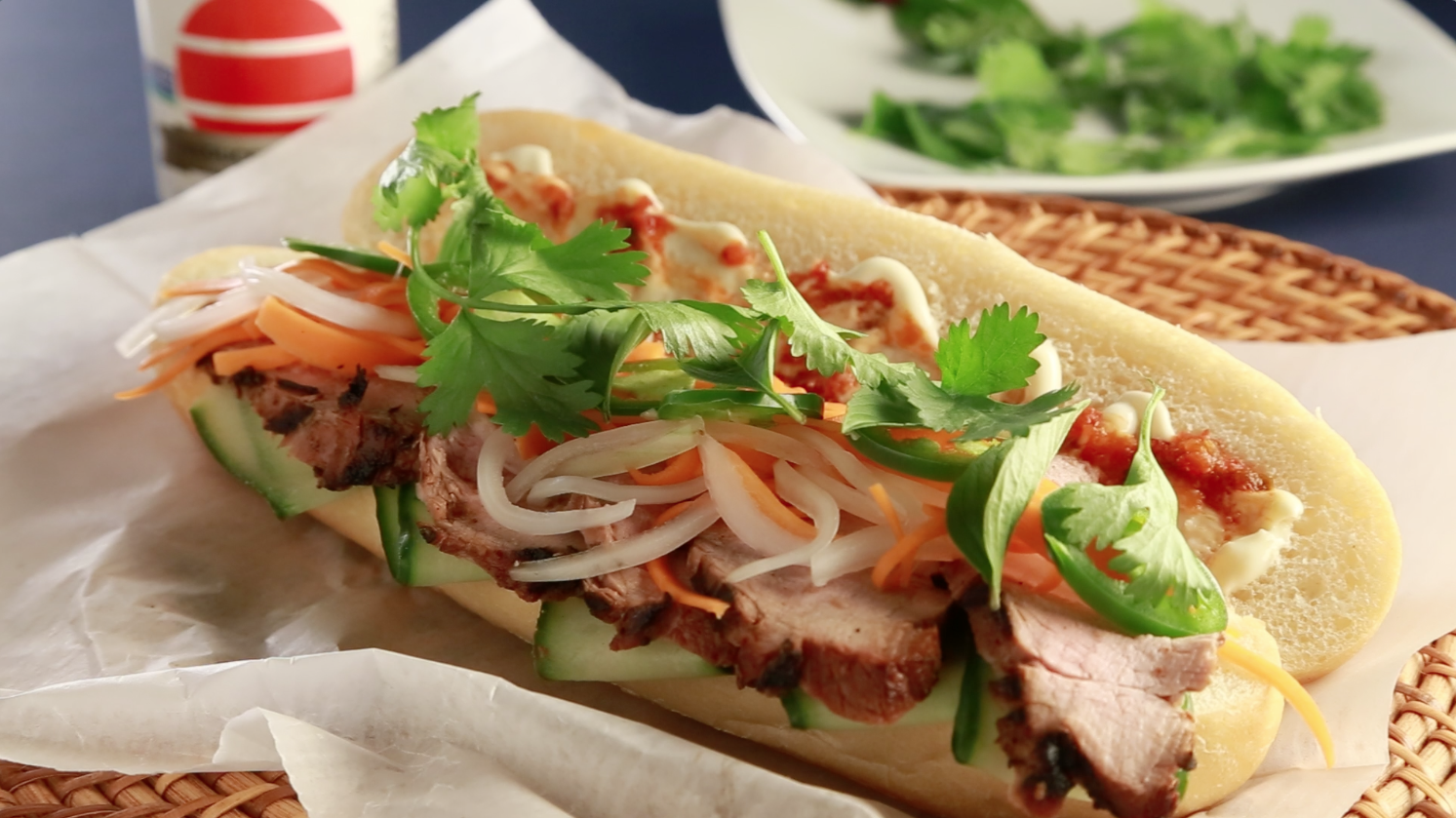 This spicy-fresh Vietnamese sandwich layers thin slices of tender marinated grilled pork tenderloin with crunchy pickled veggies, fresh-cut jalapeno, thin ribbons of cucumber and spicy chile mayo on a French baguette. Banh Mi perfection crafted in the Food Channel's very own kitchen!