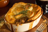 Beef & Guinness Stout Pie is a traditional Irish pub favorite that features creamy rich Guinness Stout-braised beef with caramelized mushrooms and fresh thyme. It's then baked hot and bubbly topped with golden flaky puff pastry.