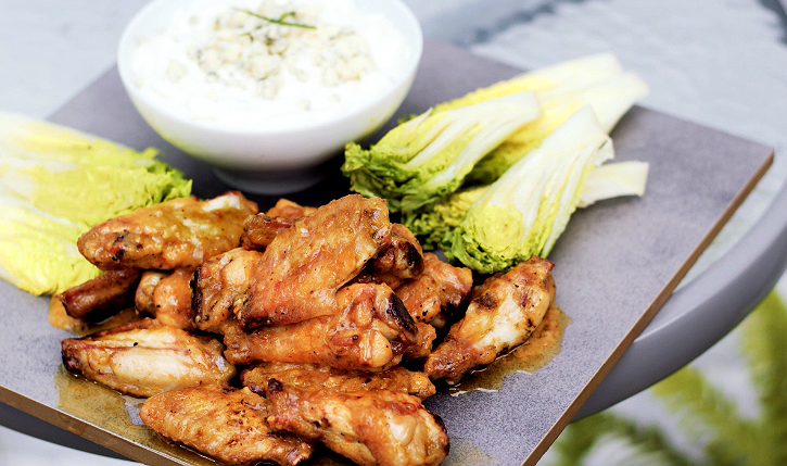 Traditionally buffalo wings are fried, but they don't have to be fried to be bold in flavor. Chef Cari Martens shares her favorite grilled buffalo chicken wings that are not nearly as calorie packed.