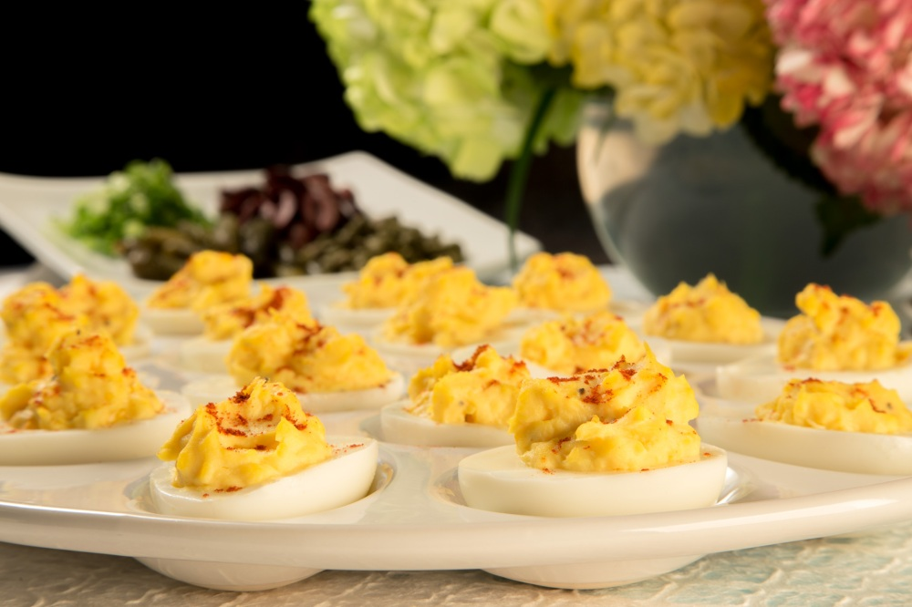 Deviled Eggs. Grandma's classic has come into the new millennium with variations that include pickle relish and mustard to ultra-chic with caviar and smoked salmon.