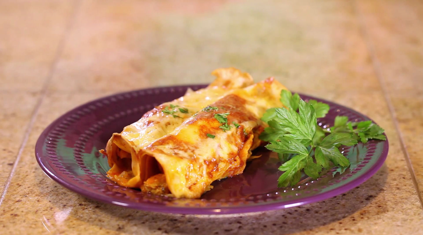 This Mexican-inspired recipe from Cooking Guru has all the ingredients to make the perfect dinner entree. Bubbly warm cheese melted on top of chicken enchiladas infused with green peppers and sour cream make this one meal your family will ask for again and again.