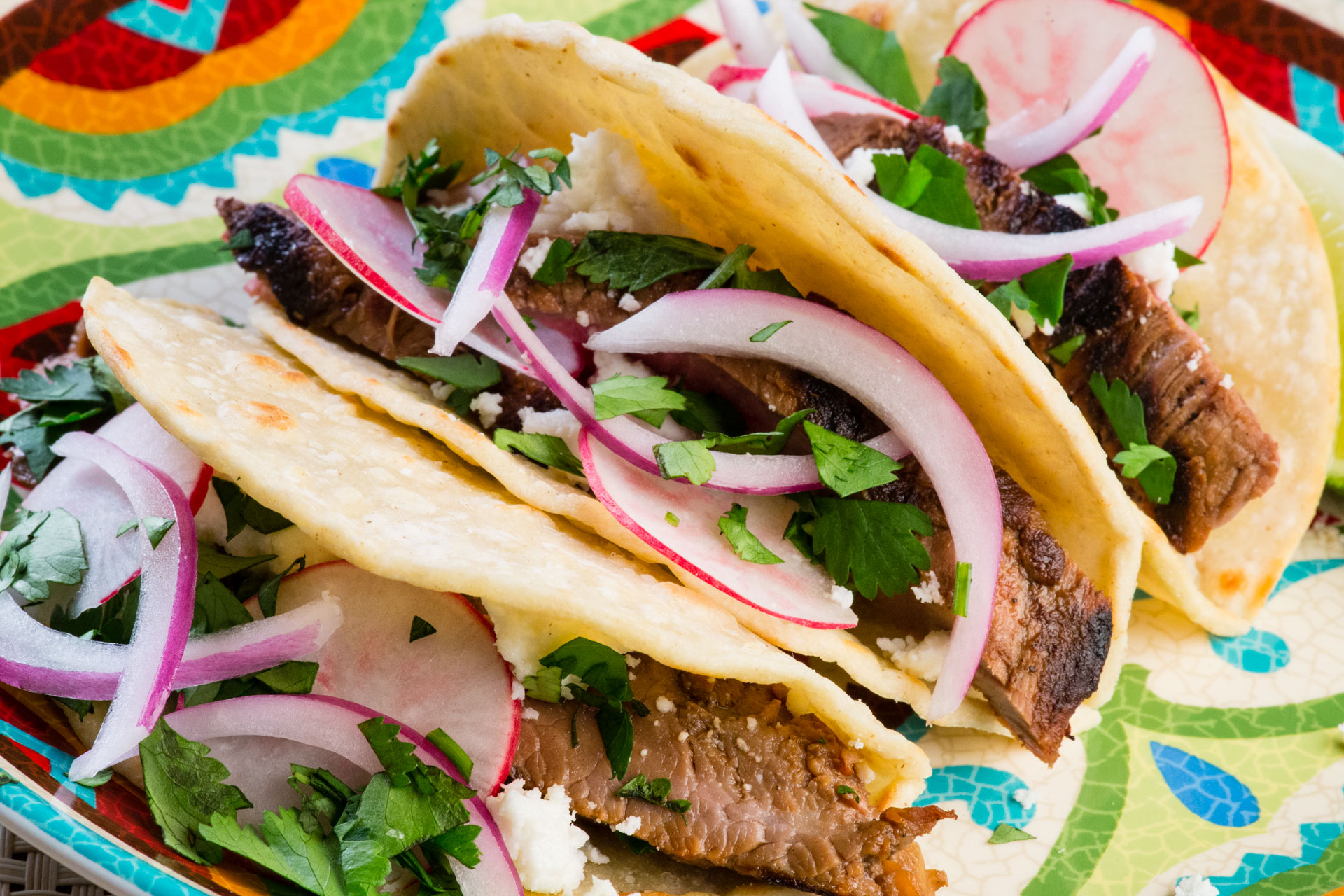 """Street"" tacos—small, portable and handheld—what's not to like? With flavor influences from beer, orange juice, and fresh lime, each mouthful is a delightful experience!"