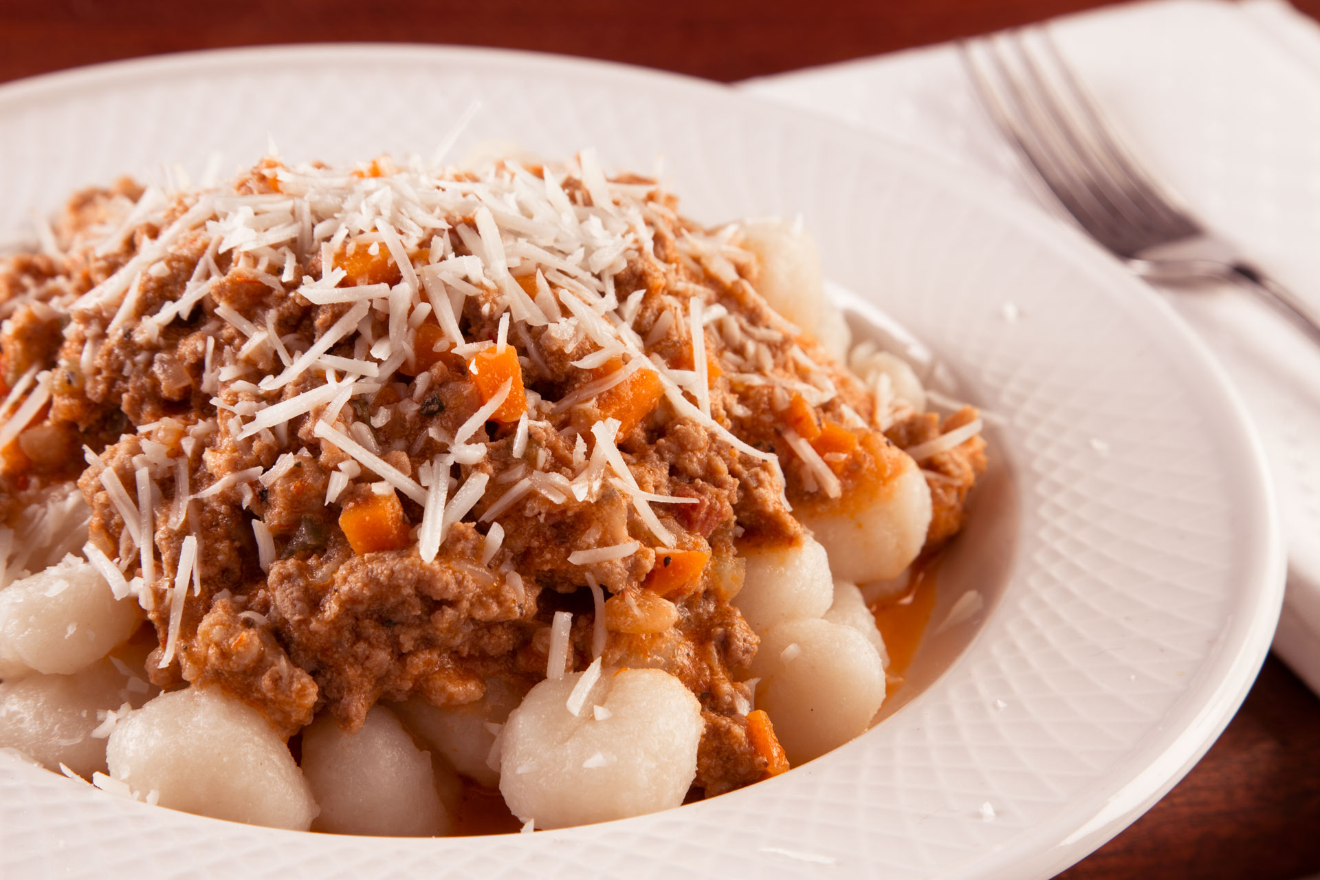 Gnocchi with Bolognese Sauce takes just a few steps to make, and makes your kitchen smell amazing!