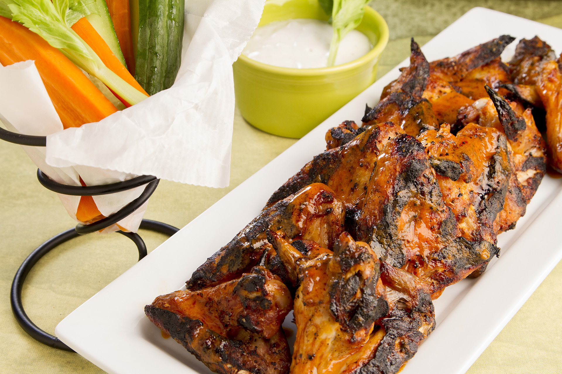 Grilled wings are a healthier alternative to fried wings, but just as satisfying. Use your favorite cayenne pepper sauce, and serve these with a chunky blue cheese dressing!