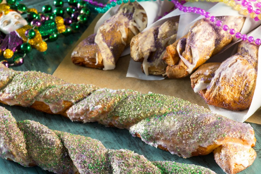 Here's a dessert fit for a king to carry around! Wrapped and shaped into a twist, this version of a King Cake Twists will have everyone eating out of your hands.
