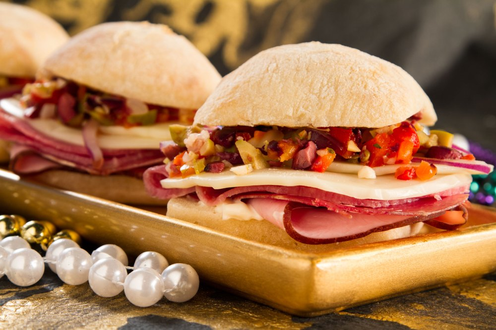 Try this bayou classic out at Mardi Gras or turn your dinner into an authentic Louisiana experience by serving this muffuletta that is stuffed with cheese, three kinds of meats, and a unique creole relish.