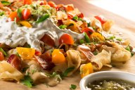 Smothered in Irish ale cheese sauce, bacon, jalapenos, smashed avocado, zesty chive and sea salt-seasoned sour cream, these all-American Irish pub grub nachos are a fan favorite.