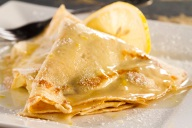 This is a homemade Lemon Sauce prepared with fresh lemon, grated lemon peel, butter, sugar and more. The Raspberry Crepe is an added bonus, but this Lemon Sauce would be great on any dessert.
