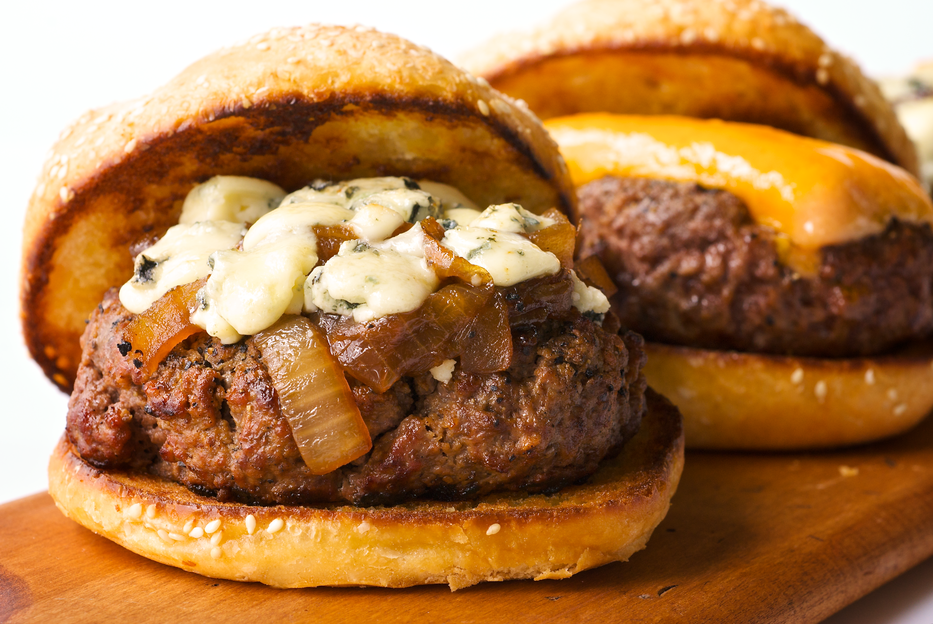 This delicious burger features beef patties, kosher salt, pepper, steak sauce, caramelized onions and sugar, and oh-so-flavorful bleu cheese.