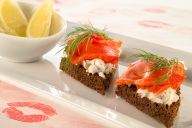 This smoked salmon dish–otherwise known as lox on pumpernickel–offers a classic combination of cream cheese, capers, red onions and smoked salmon. The perfect Valentine's Day appetizer!