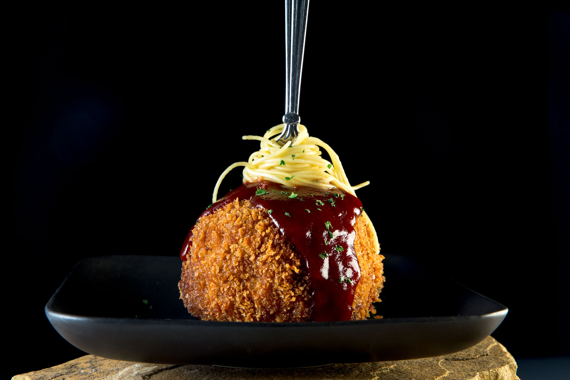 This softball-size meatball, made to resemble an Italian meatball impaled with a forkful of pasta, holds a secret filling. The Big One is actually a deep-fried meatball filled with a molten center of smoky pulled pork, two kinds of cheese and BBQ sauce!