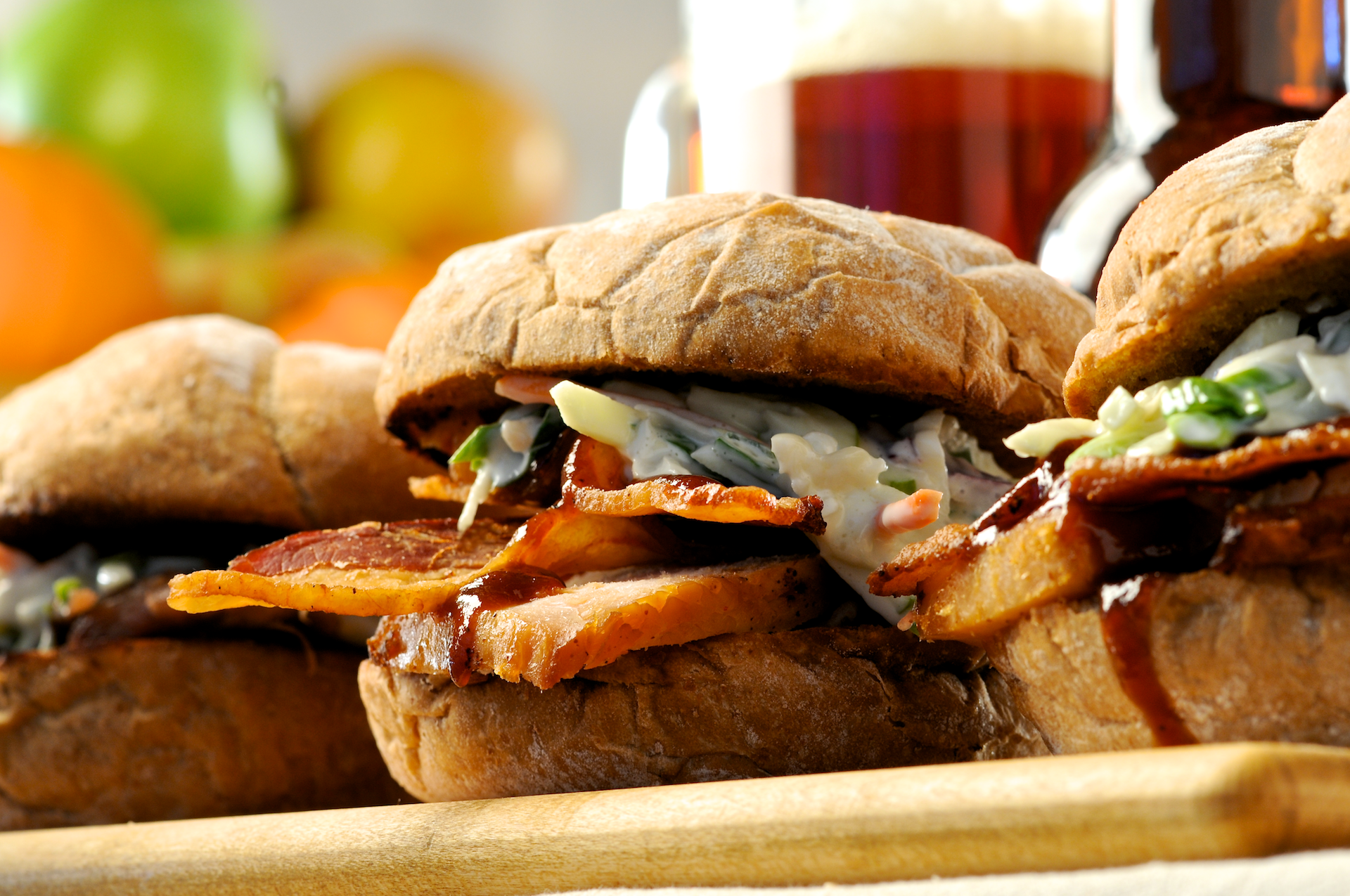 Hearty BBQ smoked chicken or pulled pork sandwiches layered on toasted Kaiser rolls with crisp Applewood-Smoked bacon, smoky-sweet cider barbecue sauce and crunchy apple slaw. Tasty!
