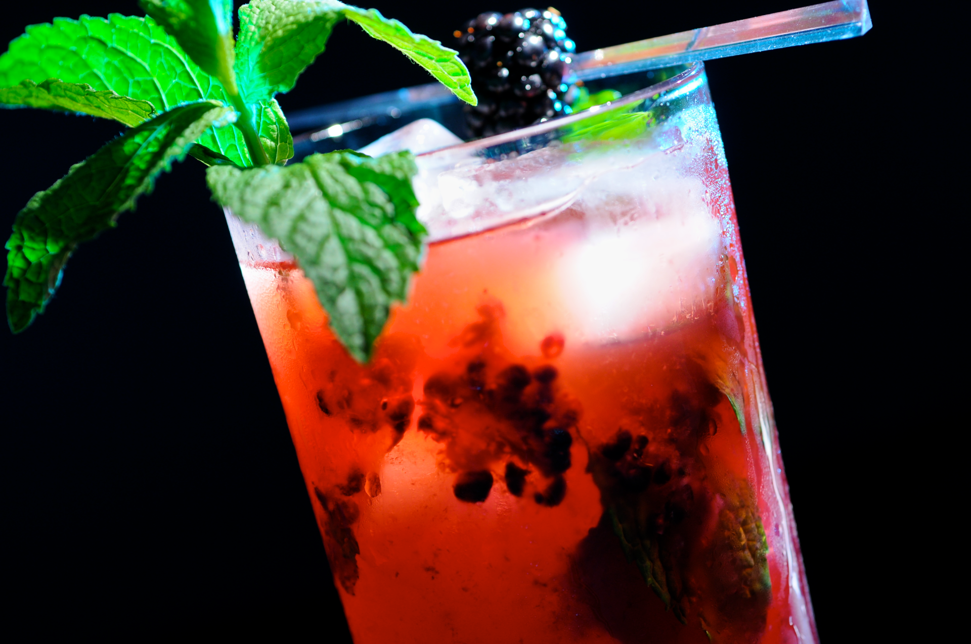 A wonderfully light, slightly tart, and refreshing rum drink flavored with mint, lime juice, and fresh blackberries.