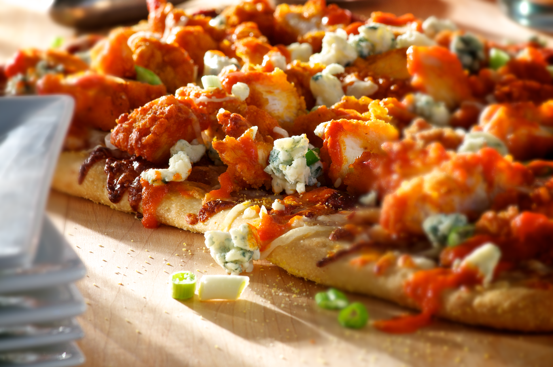 Everything you love about crispy chicken tossed in a buttery, hot-and-spicy Buffalo sauce piled on a golden bubbly cheese pizza garnished with crumbled bleu cheese, fresh-chopped green onions and even more zesty Buffalo sauce.