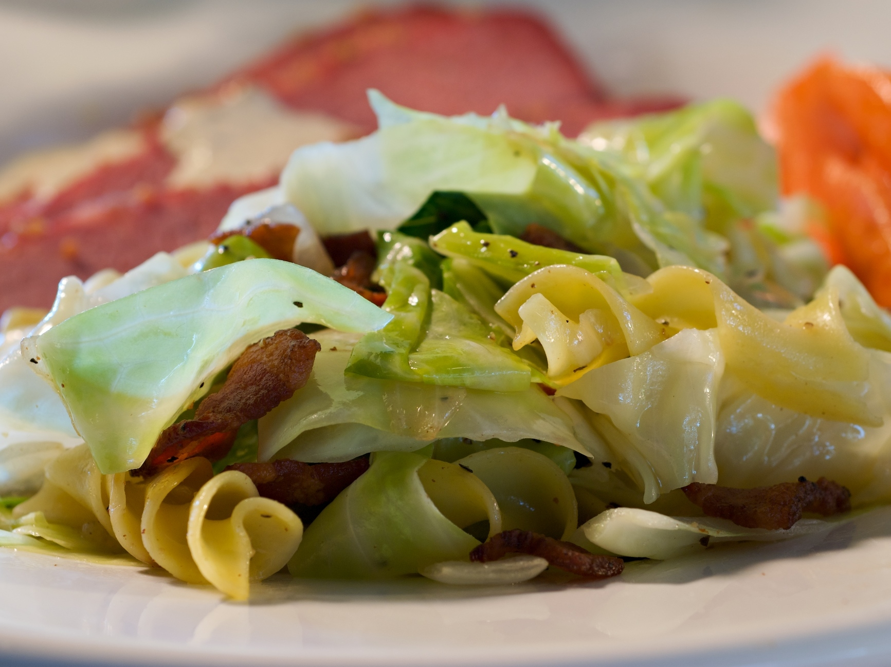 The total Irish comfort food! Smoky bacon, the crunch of green cabbage, and tender noodles make this dish completely mouthwatering and craveable.
