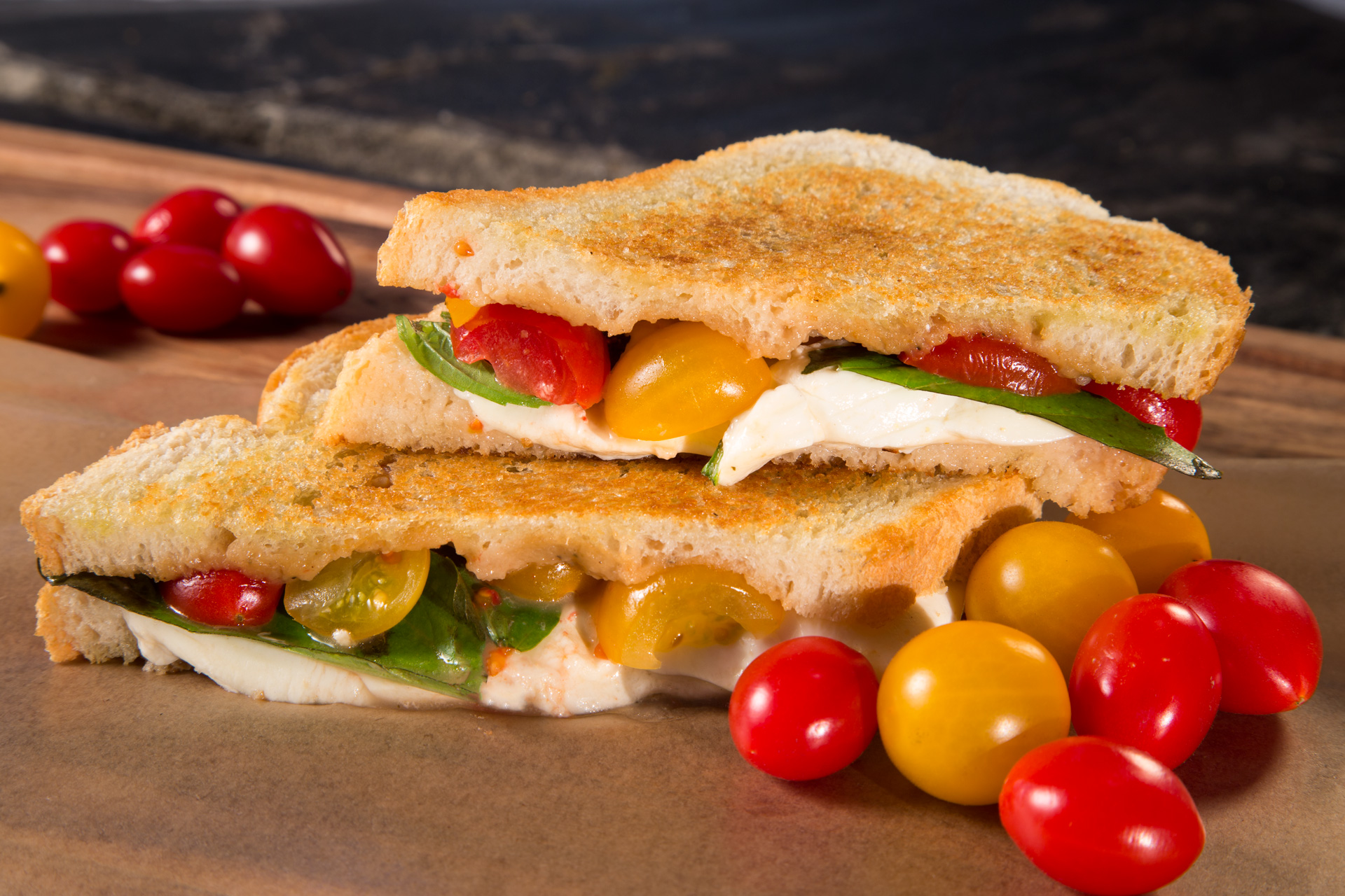 It's a Caprese Grilled Cheese! Here's a summertime sandwich that will surprise and delight your family and friends with a mix of comfort food and special occasion treatment!