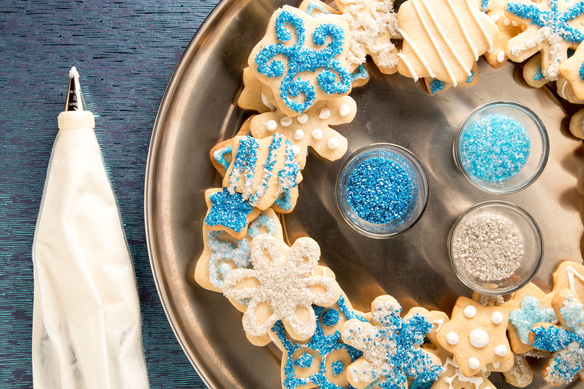 Cardamom Shortbread Snowflakes are a great rolled dough cookie that can be used for decorating OR eating. We prefer both, so we turned our cookies into a wreath (the ones we didn't eat first, of course).