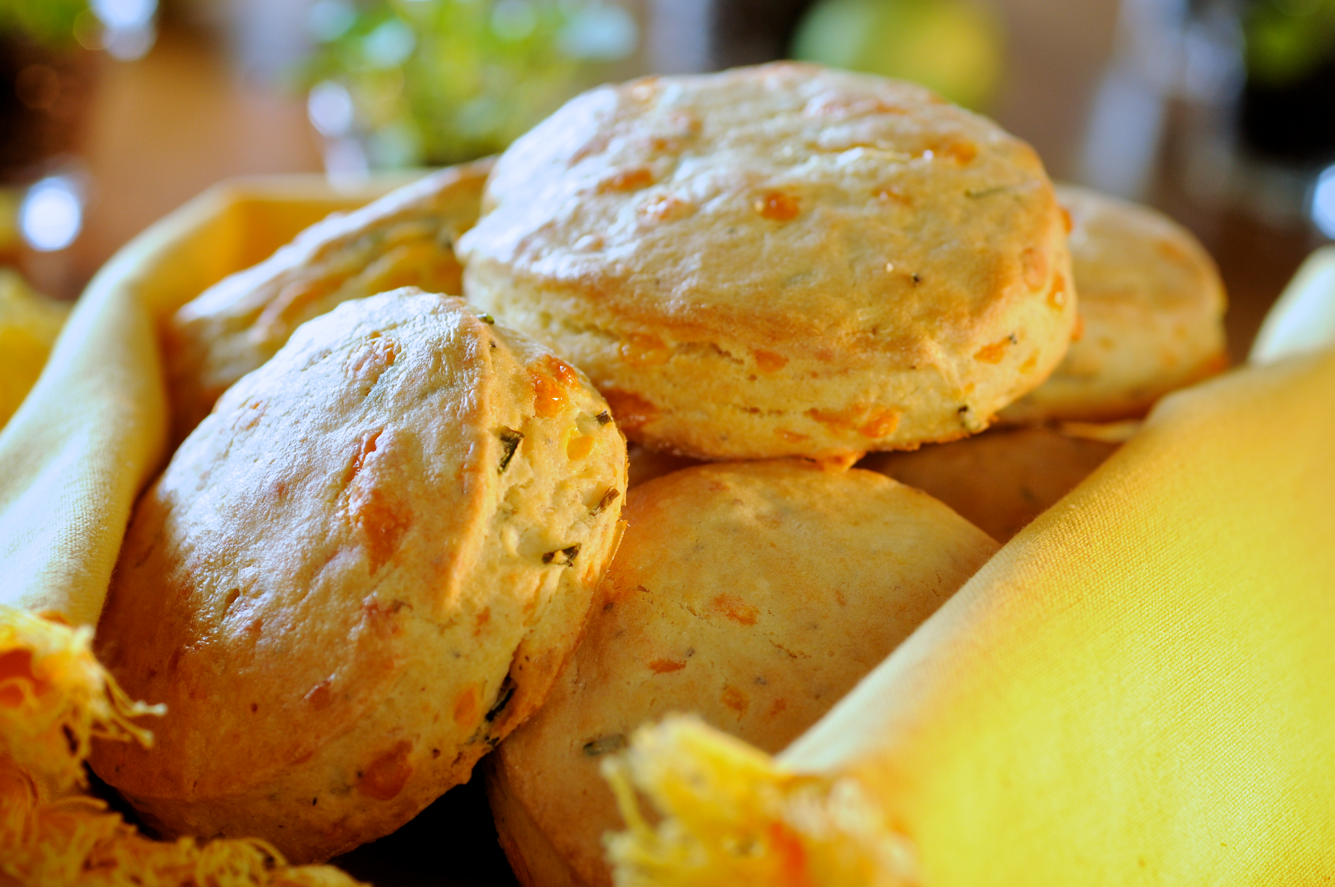 These warm and cheesy scones make an unexpected and welcome addition to any meal. These scones are full of flavor. Try them with dinner and maybe even breakfast.
