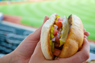 Classic hot dogs from the Windy City piled high with sweet pickle relish, tomatoes, onions, mustard, and a pickle spear.