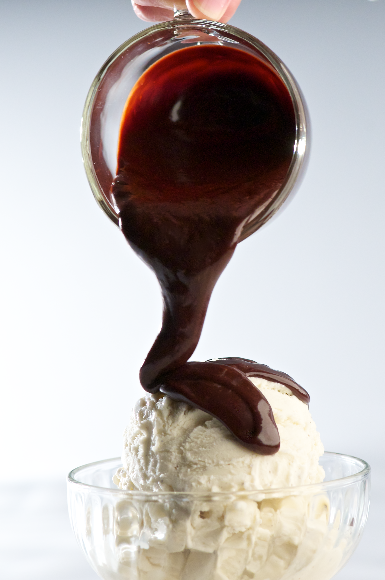 This dark glossy artisan-style dark chocolate sauce has a rich bittersweet chocolate flavor, velvety smooth texture and tastes wonderful served warm, drizzled over ice cream and desserts.