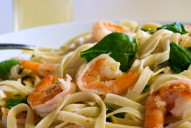 Many shrimp scampi recipes are overloaded with butter; this recipe is balanced with a blend of butter and monounsaturated olive oil and tossed with fresh baby spinach. It's rich in B vitamins, omega-3 fatty acids, beta-carotene, calcium and important phytochemicals.