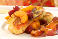 Peaches and raspberries are the perfect addition to the light sweetness to buttery French toast that's great with a side of crispy bacon or sizzling sausage.