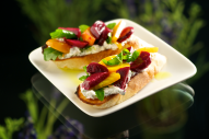 This hand-held appetizer combines beet arugula salad with goat cheese for an unexpected and delightful taste experience. These would make great canapes at a cocktail party.