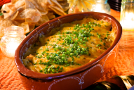 Creamy and cheesy, this is a dish the whole family will love; it's got just enough kick from the chiles and it's loaded with tender pulled chicken breast and gooey cheese.