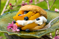 Light and airy, these biscuits are cake-like when they're topped with cream and sugar, and then stuffed with bright peaches, blueberries, and pillows of whipped cream.