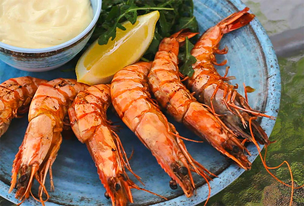 This recipe makes it easy to cook perfectly grilled prawns over an outdoor barbecue for maximum flavor! The prawns take very little time, just enough to turn the flesh opaque, and you have delicious grilled seafood.