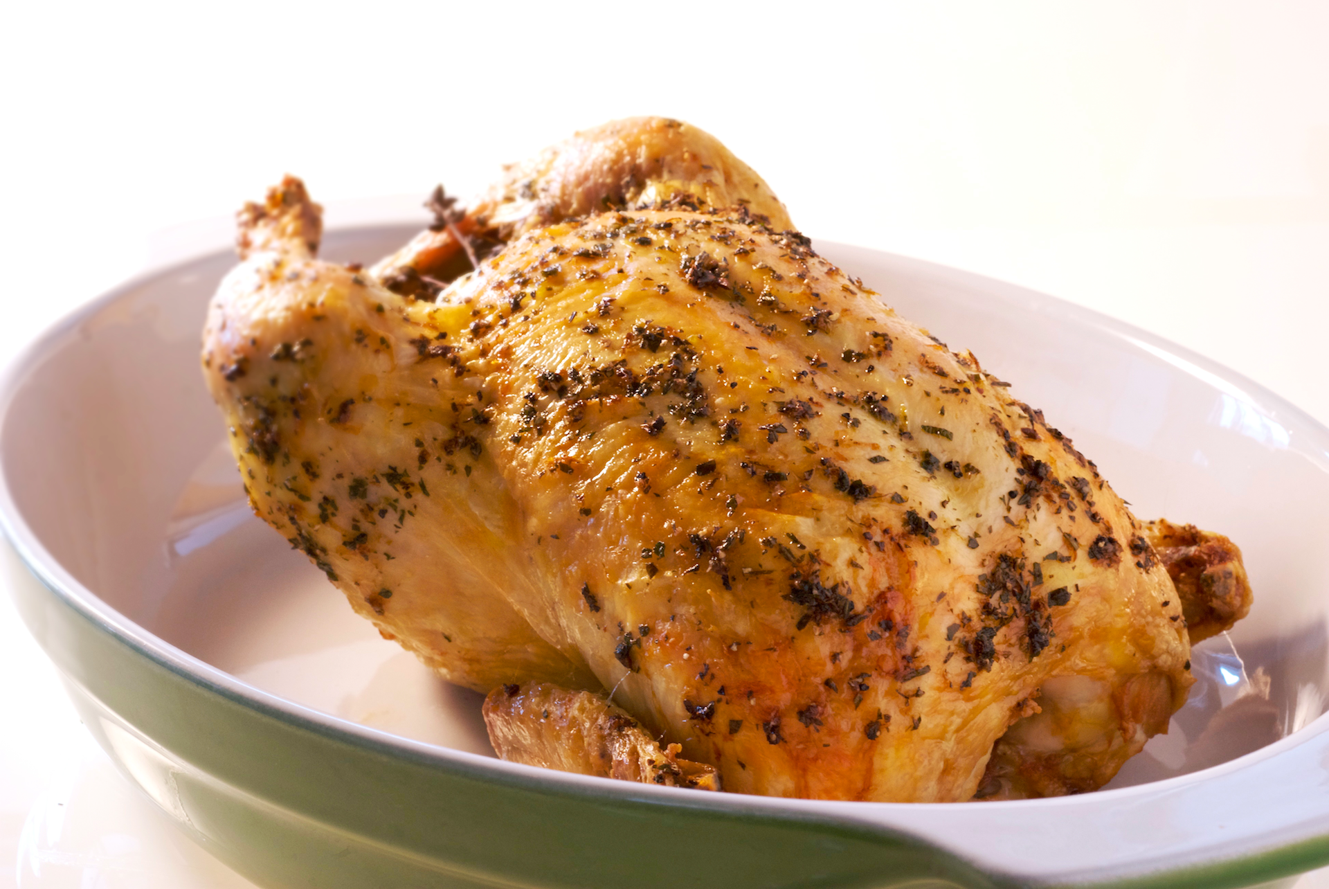 This succulent herb-roasted chicken seasoned with lemon, garlic and fresh herbs will fill the entire house with a rich, comforting aroma as it slowly roasts in the oven. Allow the chicken to rest prior to carving to ensure that all the succulent juices remain in the meat and not on your cutting board.