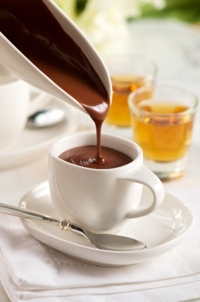 This simple recipe for two is similar in its richness to a great espresso drink. It's a dark and decadent sipping chocolate served hot, and a little goes a long way toward creating a perfect romantic moment.
