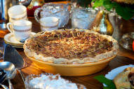 Silky-rich sweet potato pie topped with a layer of golden caramelized pecan pie, this authentic Southern pie offers a standout dessert for the holiday. Wonderful topped with a scoop of cinnamon ice cream or a dollop of whipped cream