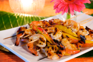 The tropical flavors of mango and ginger paired with the Latin heat of jalapenos and tequila turn shrimp into a sweet and glossy appetizer or main dish.