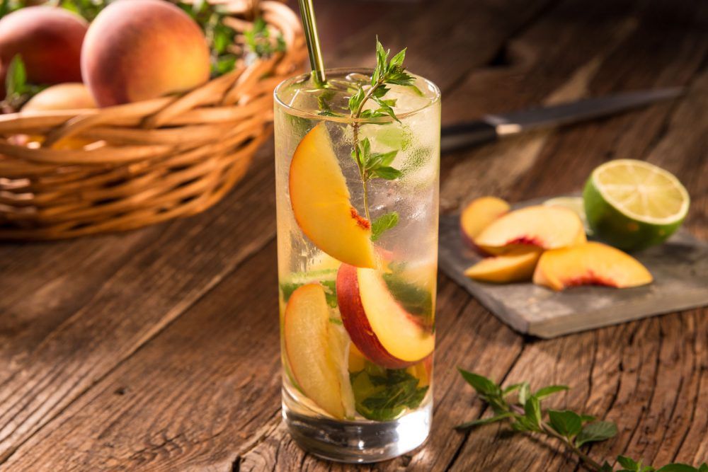 We used Van Gogh Cool Peach Vodka in our mojito, paired with fresh mint, simple syrup, fresh lime and ripe juicy sliced peaches. Served over ice topped with club soda.