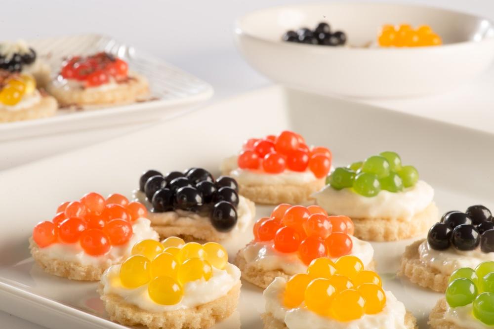 photo of crackers topped with boba flavor pearls that looks like caviar for kids