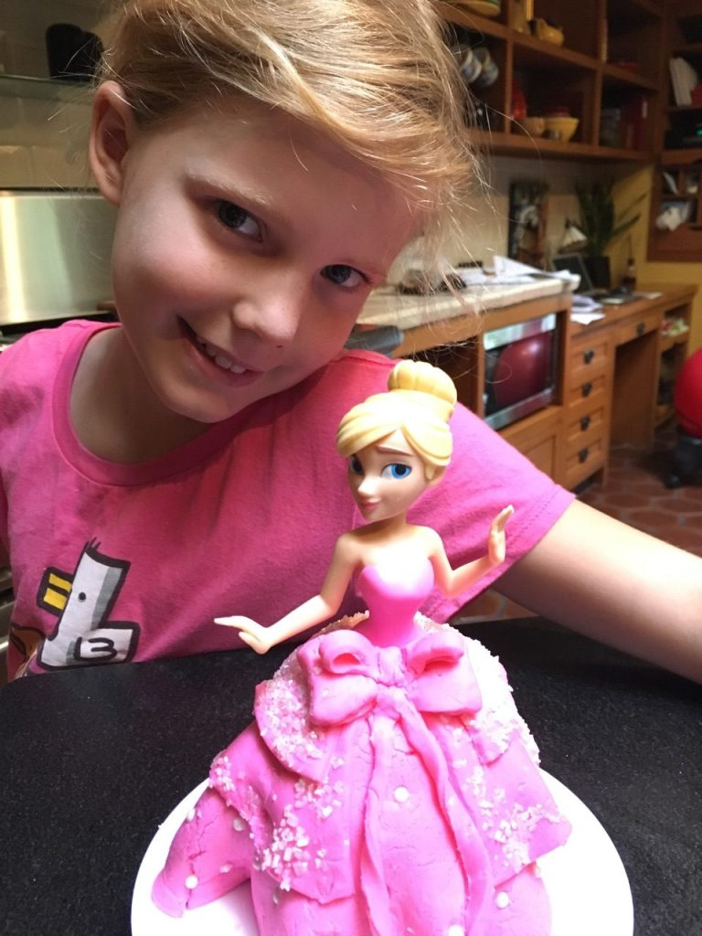 Photo of Chef Penelope with the finished Princess Cake she baked at home.