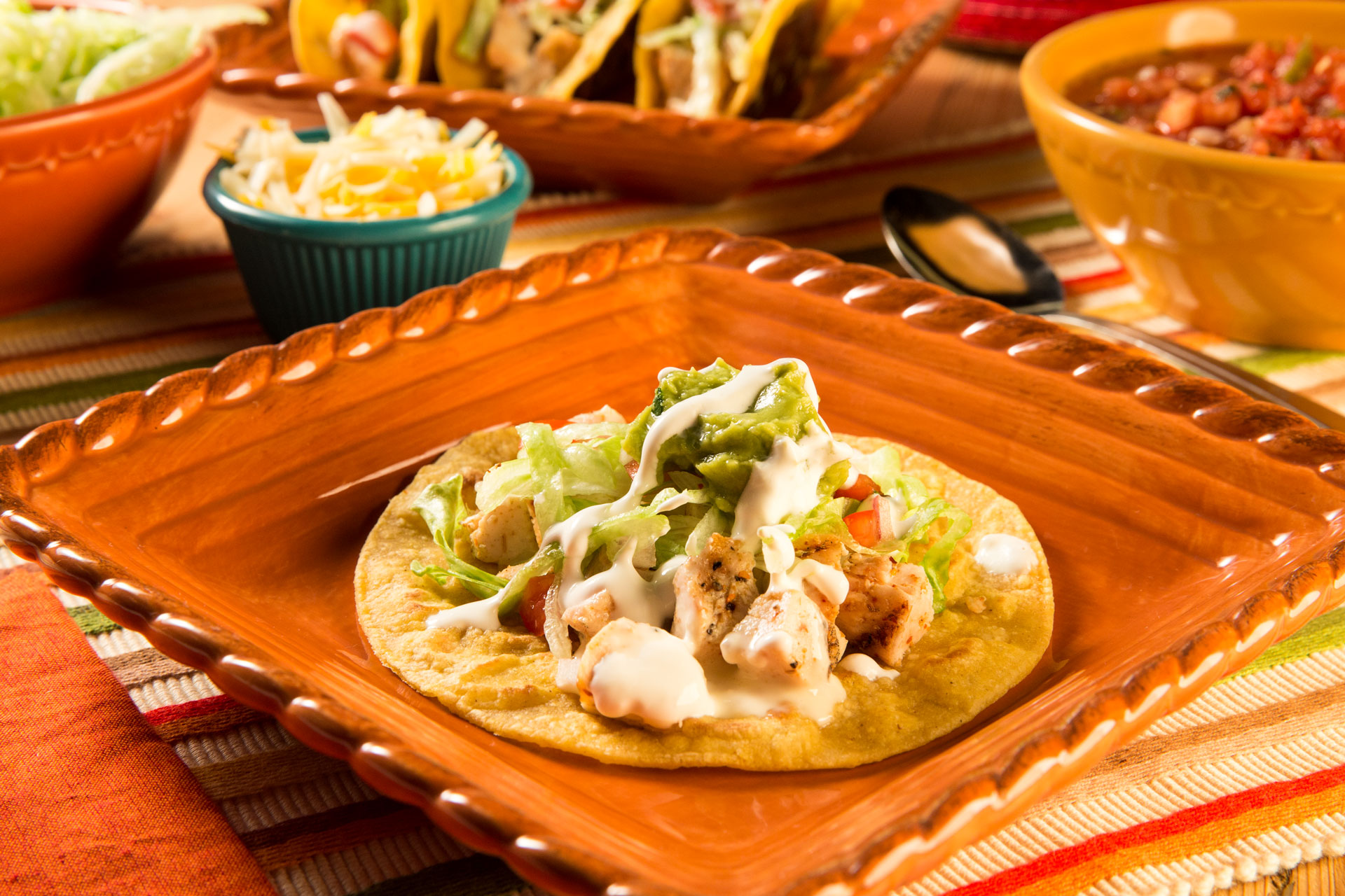 Perfect for a busy night, this fun recipe uses leftover grilled chicken seasoned with Mexican seasoning, topped with white queso sauce and stuffed in a crisp skillet-griddled corn tortilla taco. Taco Tuesdays are anything but boring and a fun way to celebrate with a school-related theme.