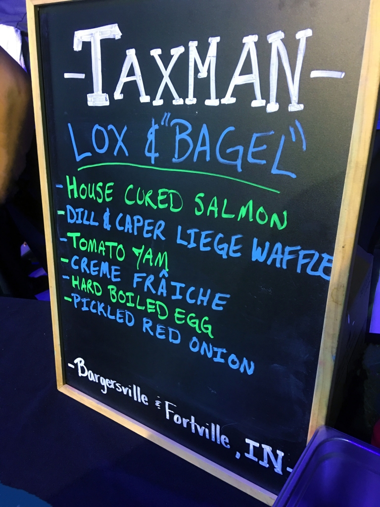 Restaurant menu chalkboard outlining offerings from Taxman Brewery at the Baby Got Brunch event