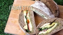 Picnic loaf sandwich made by hollowing out a loaf of bread and stuffing with a variety of fillings.