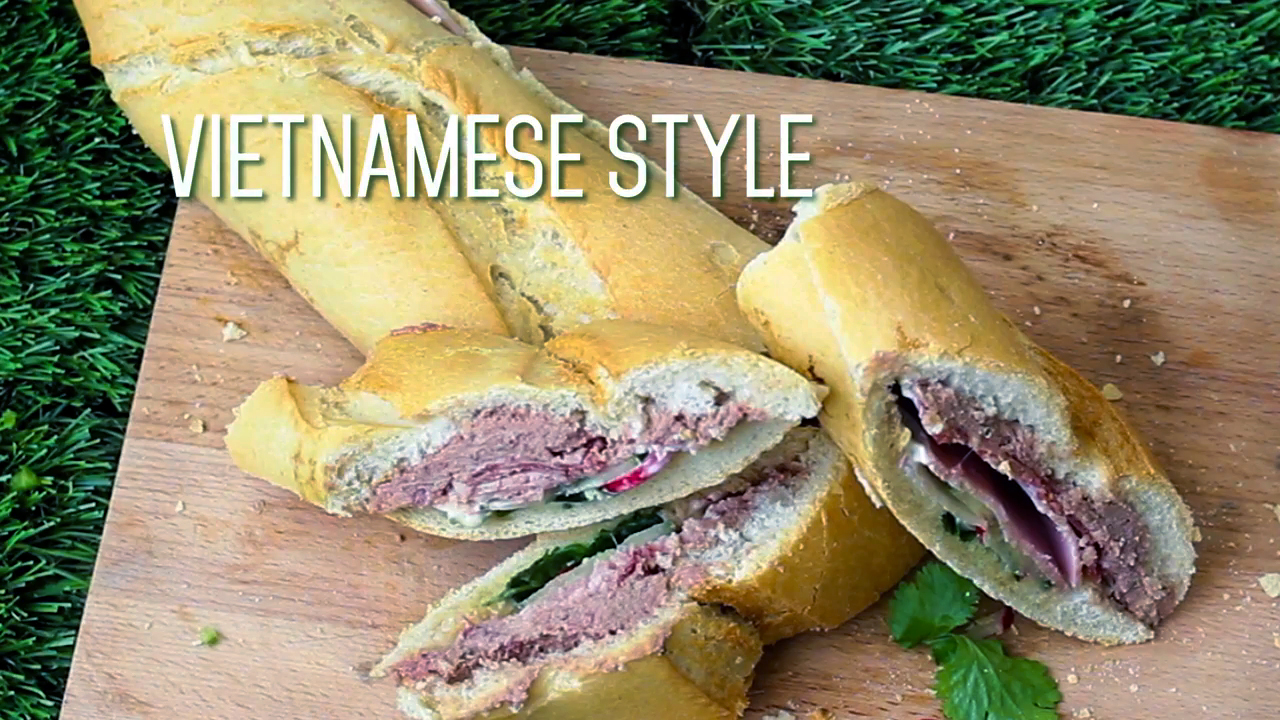 Vietnamese-Style Picnic Loaf sandwich made by hollowing out a loaf of bread and stuffing with a variety of fillings.