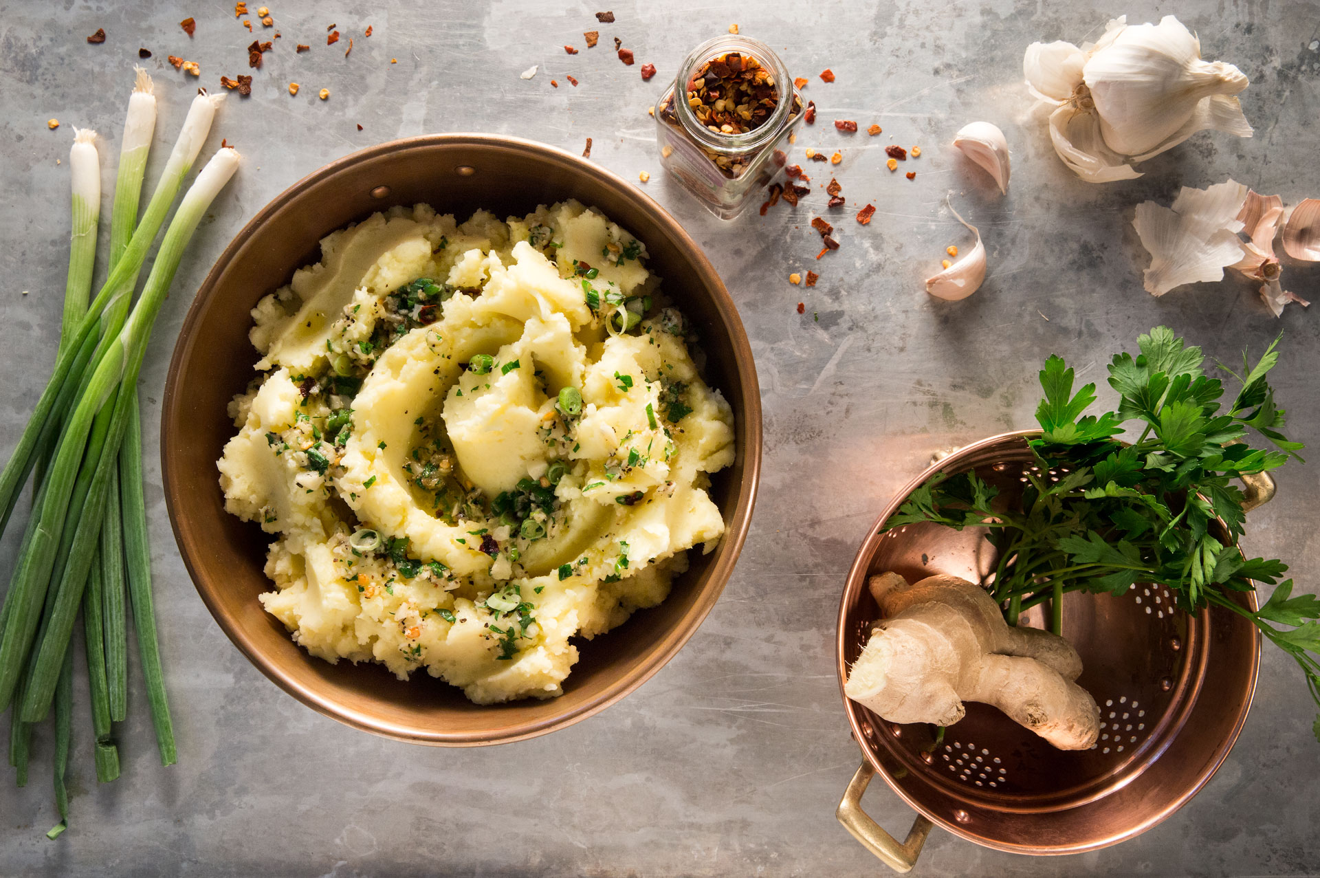 We added the bold craveable flavor combination of olive oil-sautéed garlic, aromatic fresh ginger and crushed red pepper flakes to mashed Yukon gold potatoes for this new fall take on a comfort food classic.
