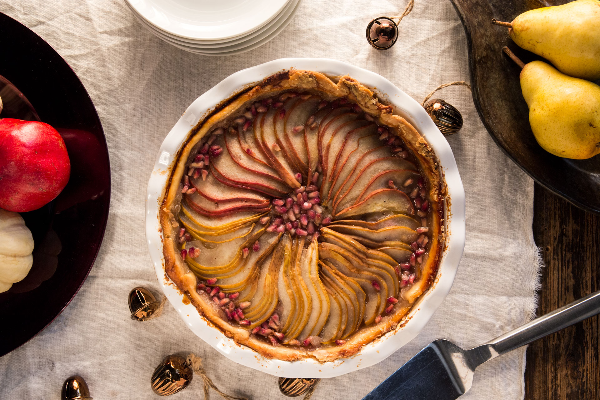 This pie combines sweet and tart flavors with fresh fruit to create a unique but familiar offering that celebrates traditional seasonal ingredients with trendy twists such as pomegranate arils. It also makes a beautiful centerpiece for the dessert table if it is made with multiple pear types.