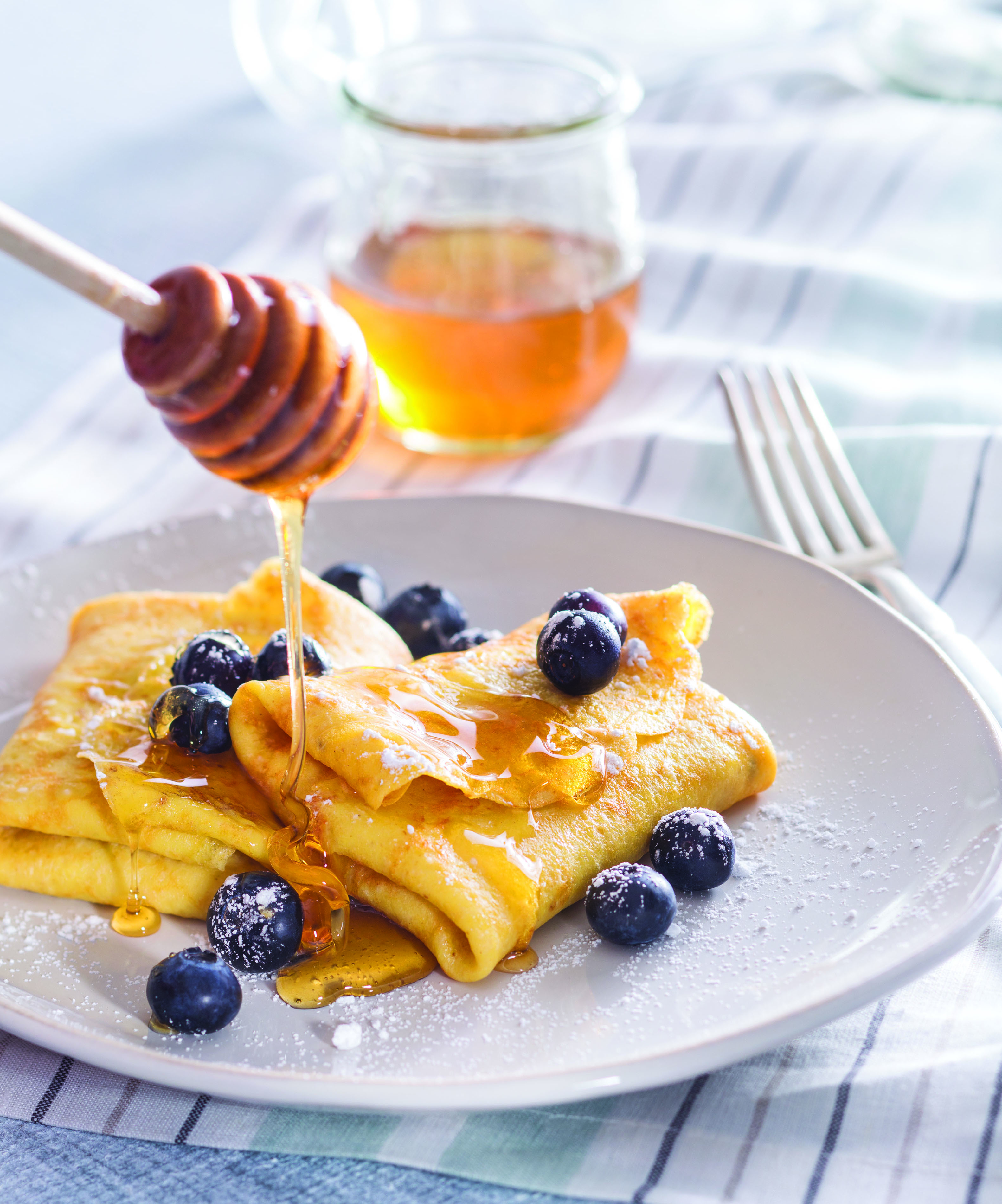 Photo of plated blueberry blintzes with honey, taken for the National Honey Board.