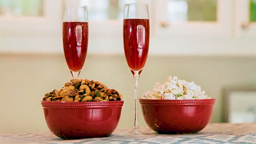 I have the perfect holiday trio for you, Truffle Popcorn, Spiced Nuts and a Cranberry Negroni. These holiday snacks are going to be perfect for your next party! There's no substituting homemade popcorn and nuts and when paired with a holiday cocktail, the Cranberry Negroni. With a little bit of easy prep, this Trio of Holiday Snacks will impress every guest this season.